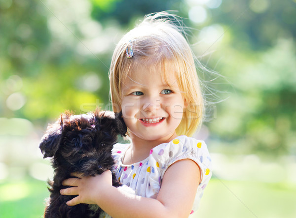 Cute little girl hugging dog puppy outdoors Stock photo © dashapetrenko