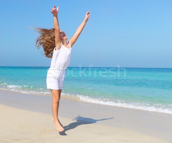 Cute little girl jumping on the beach Stock photo © dashapetrenko