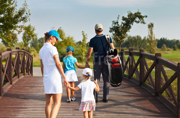 Family of golf players walking at the course Stock photo © dashapetrenko