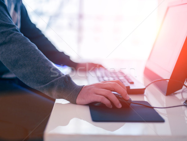 Male hand holding computer mouse with laptop keyboard Stock photo © dashapetrenko