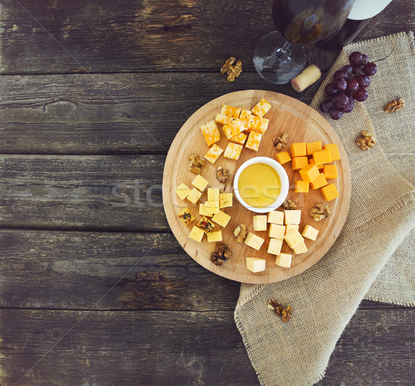Grape, set of different kind of cheeses with a glass of red wine Stock photo © dashapetrenko