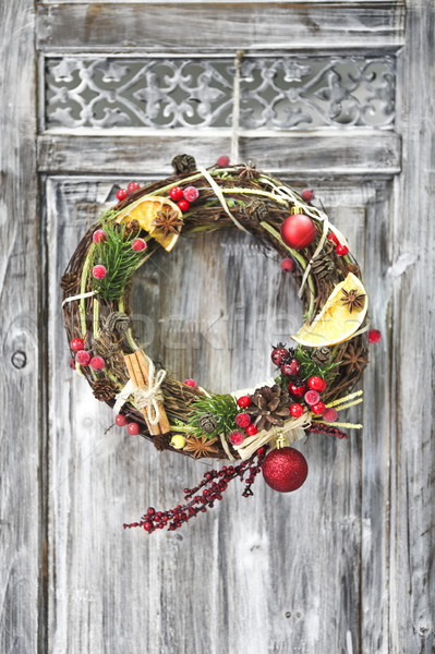 Christmas handmade wreath on wooden door.  Stock photo © dashapetrenko
