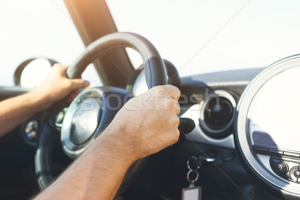 Cropped view of young man driving car Stock photo © dashapetrenko
