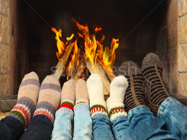 Feet warming near the fireplace Stock photo © dashapetrenko