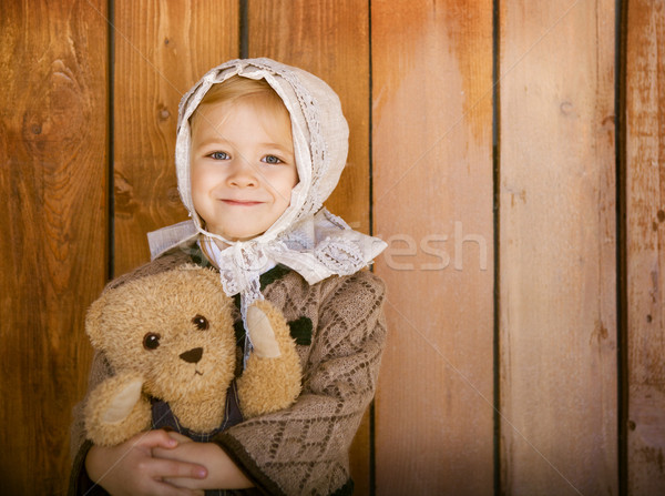 Portrait of the little smiling girl wering vintage clothes with  Stock photo © dashapetrenko
