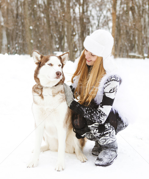 Happy young woman in the winter park with dog Stock photo © dashapetrenko