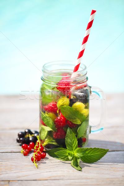 Glass of natural berry lemonade Stock photo © dashapetrenko