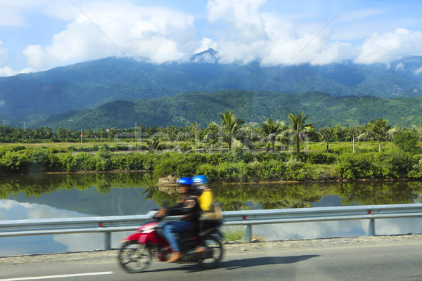 People rides motorcycle on a road in Vietnam Stock photo © dashapetrenko