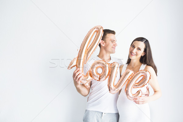 Jovem feliz mulher grávida homem amor branco Foto stock © dashapetrenko