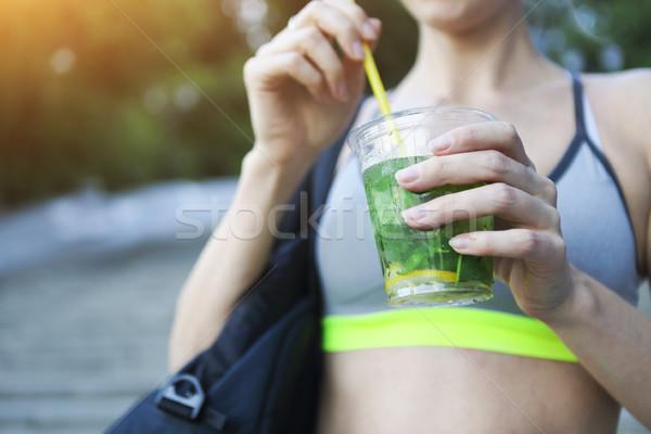 Woman drinking herbal tisane after fitness running workout on su Stock photo © dashapetrenko