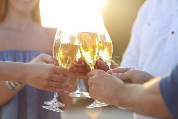 Happy friends with champagne sparkling wine in glasses outdoors  Stock photo © dashapetrenko