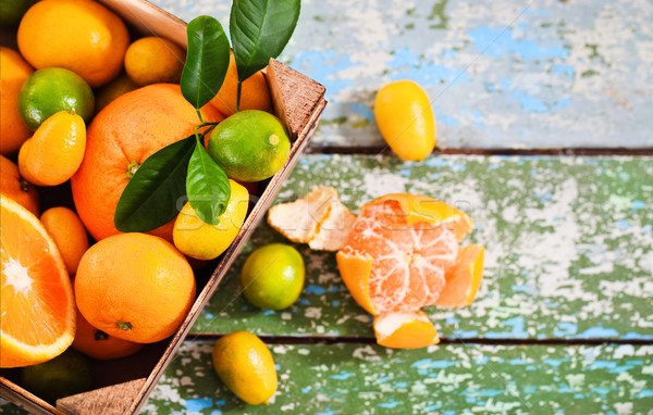 Fresh citrus fruits in the wooden box  Stock photo © dashapetrenko