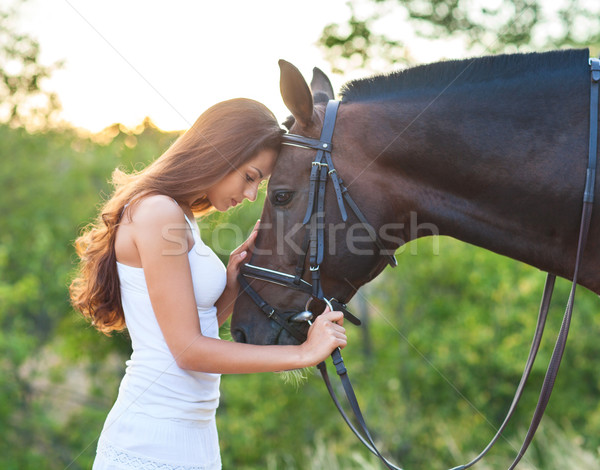 Portrait beautiful woman with long hair next horse Stock photo © dashapetrenko