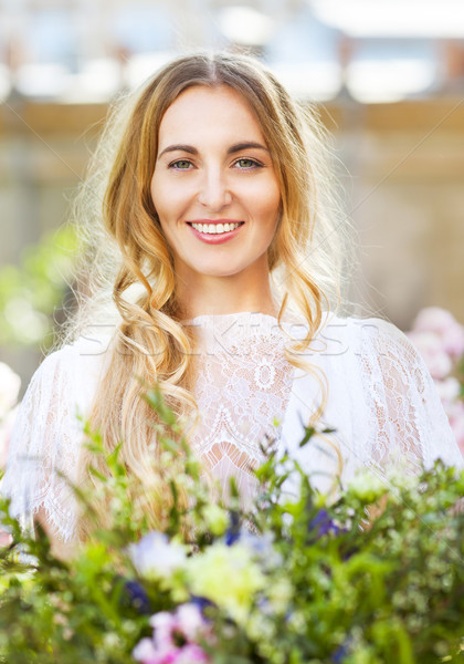Bride with beautiful wedding bouquet of flowers in the style of  Stock photo © dashapetrenko