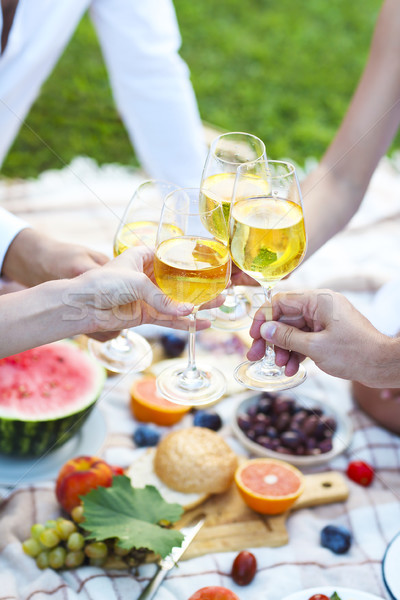 People holding glasses of white wine making a toast.  Stock photo © dashapetrenko