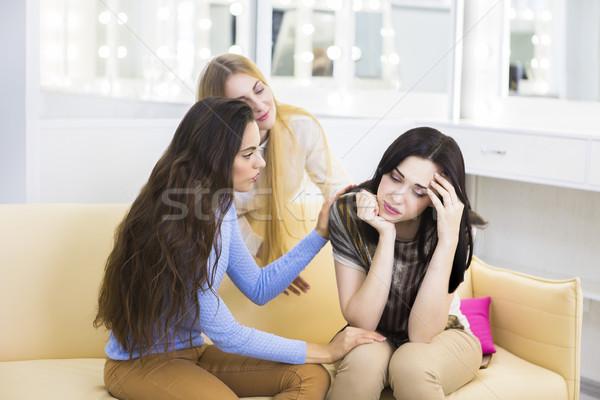 Kettő barátok szomorú nő kanapé bent Stock fotó © dashapetrenko
