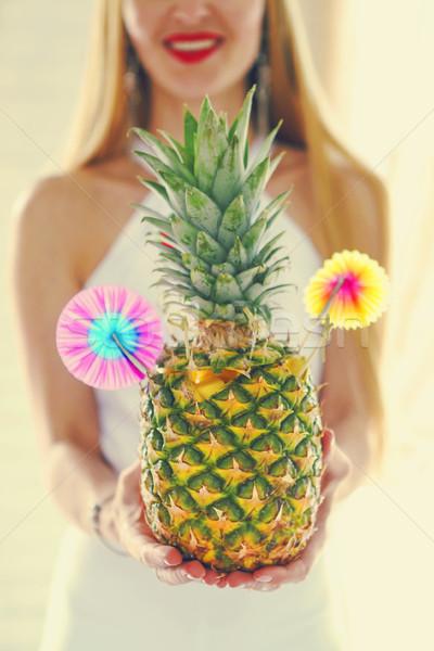 Pina colada in pineapple Stock photo © dashapetrenko