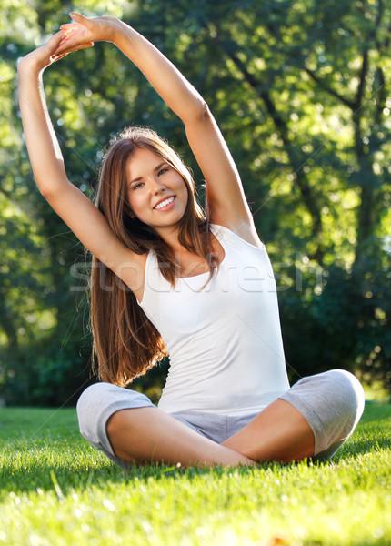 Séduisant jeune femme yoga parc été femme Photo stock © dashapetrenko