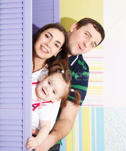 Boldog mosolyog család egyéves kislány bent Stock fotó © dashapetrenko