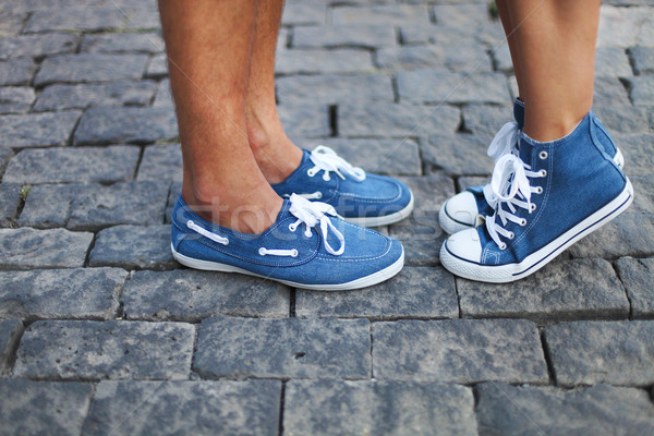 Boyfriend and girlfriend feet wearing sneakers Stock photo © dashapetrenko