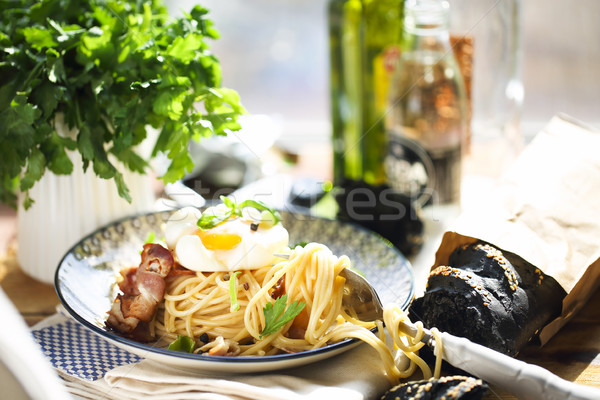 Spaghetti carbonaraby the window with arty garnish Stock photo © dashapetrenko