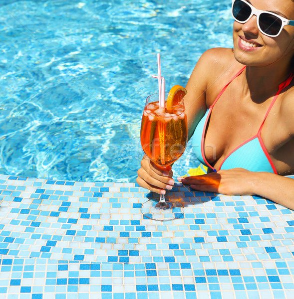 Young woman in the pool drinking cocktail Stock photo © dashapetrenko