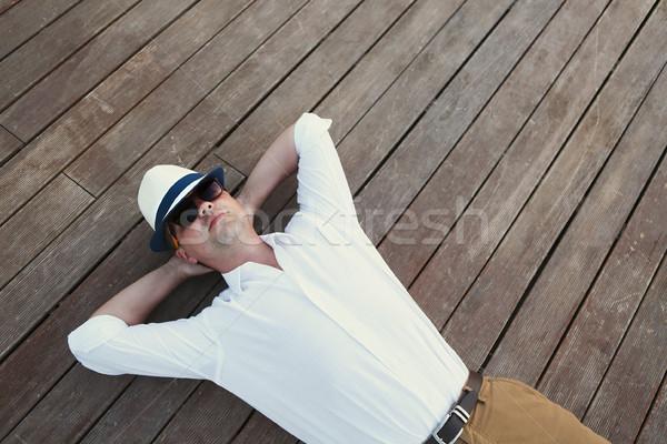 Giovane legno deck rilassante outdoor uomo Foto d'archivio © dashapetrenko