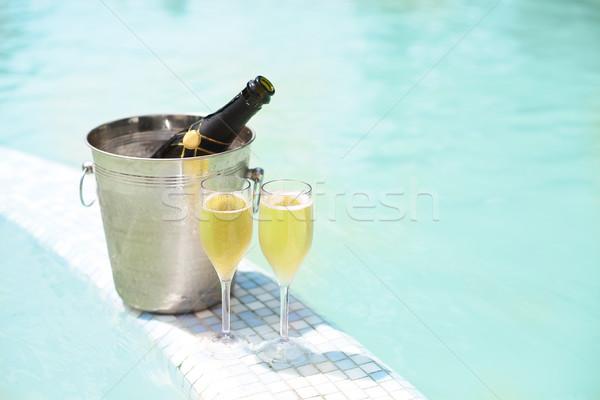 Jég vödör pezsgő üveg kettő szemüveg Stock fotó © dashapetrenko
