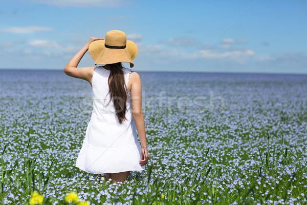Young beautiful girl in linen field Stock photo © dashapetrenko