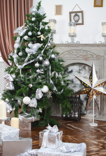 Daily interior in light tones decked out with Christmas tree  Stock photo © dashapetrenko