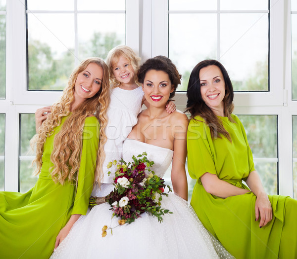 Cheerful bride with female friends and little flower girl Stock photo © dashapetrenko