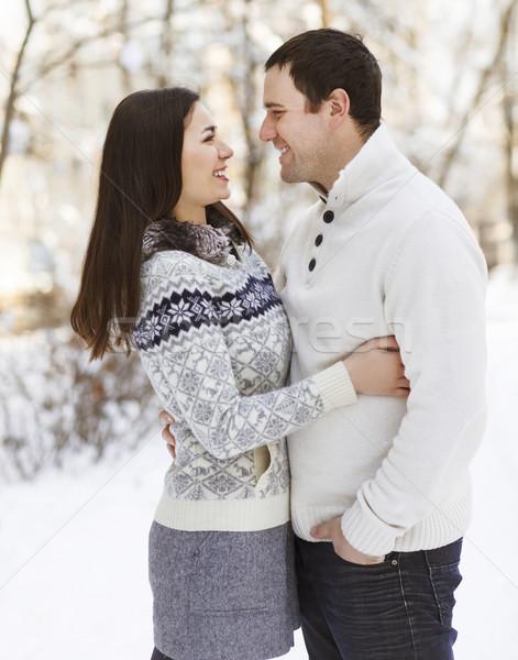 Happy couple having fun in the winter park Stock photo © dashapetrenko