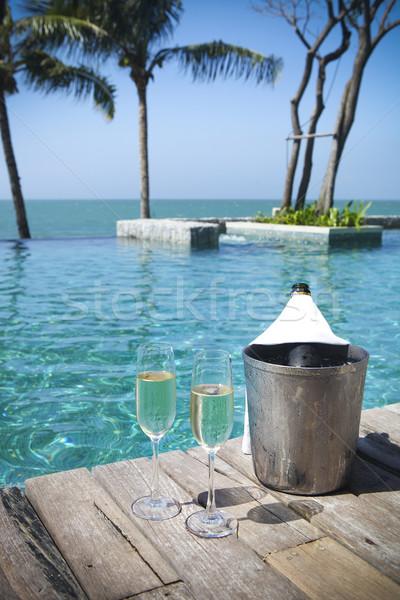 ストックフォト: シャンパン · ボトル · 氷 · バケット · 眼鏡 · スイミングプール