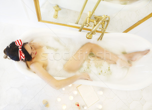 Attractive girl relaxing in the bath  Stock photo © dashapetrenko