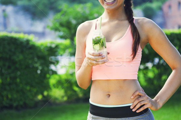 Woman drinking herbal tisane after fitness running workout on su Stock photo © dashapetrenko