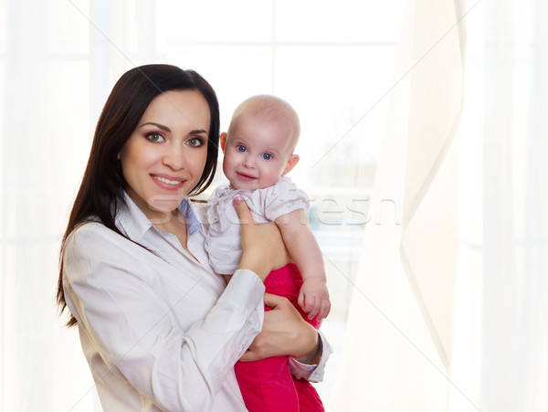 Happy smiling mother with six month old baby girl  Stock photo © dashapetrenko