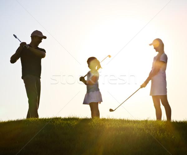 семьи закат играет гольф девушки человека Сток-фото © dashapetrenko