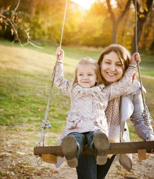 Glücklich Mutter wenig Baby Swing Bäume Stock foto © dashapetrenko
