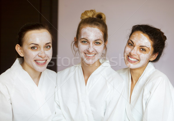 Stock photo: Three young happy women at spa resort