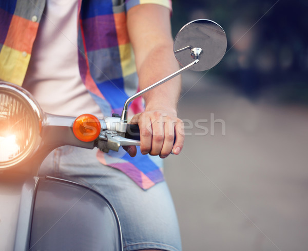 Young man riding old retro scooter in a city street Stock photo © dashapetrenko