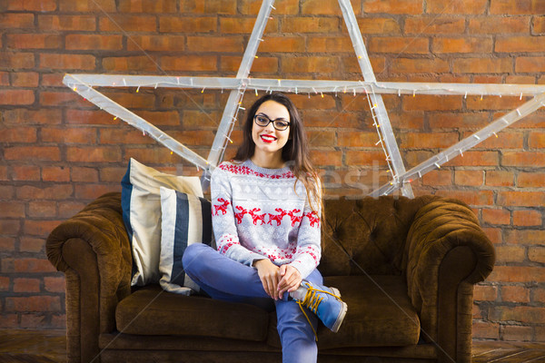 Pretty hipster girl sitting on couch at home Stock photo © dashapetrenko