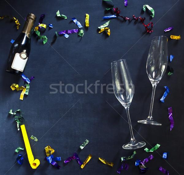 Champagne bottiglia occhiali nero multicolore confetti Foto d'archivio © dashapetrenko