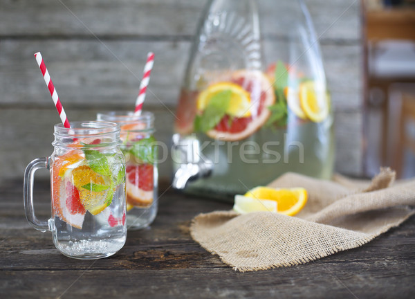Two glasses of natural homemade lemonade by the jar on the table Stock photo © dashapetrenko