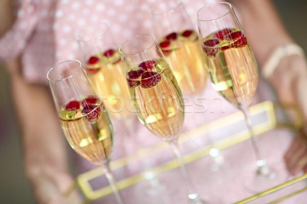 Jonge vrouw champagne bril dienblad jonge kaukasisch Stockfoto © dashapetrenko