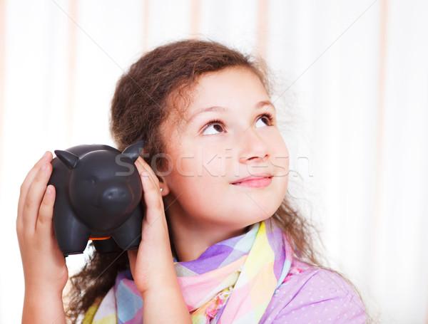 Kislány takarékosság pénz persely bent portré Stock fotó © dashapetrenko