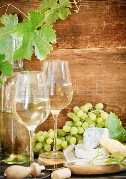 Still life with glasses of wine, bottle and chesse Stock photo © dashapetrenko