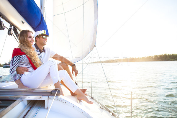 Young smiling couple on a sailing boat at summer Stock photo © dashapetrenko
