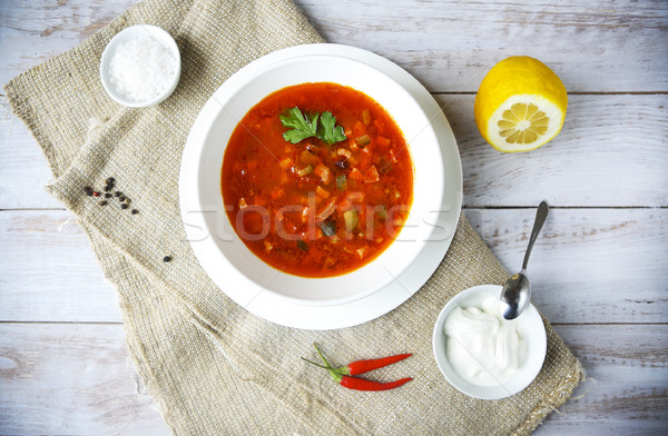 Red soup with sour cream and parsley Stock photo © dashapetrenko