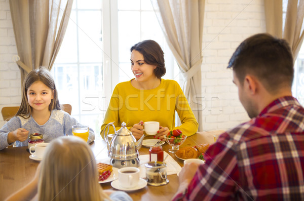 Happy family having breakfast in the kitchen of their house Stock photo © dashapetrenko