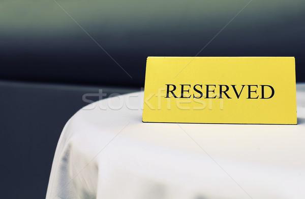 Reserved sign on the table in restaurant Stock photo © dashapetrenko